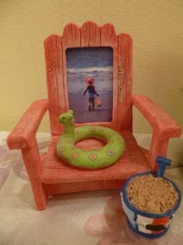 Photo of girl at beach displayed in a beach chair frame