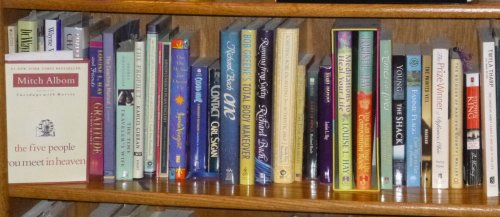 Photo showing various books on my bookshelf